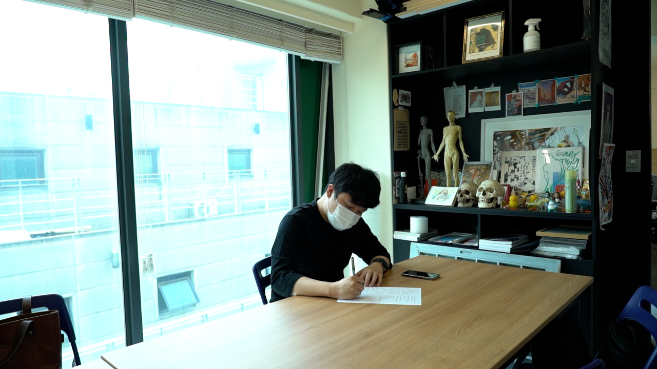 Jeon brainstorms, scribbling scripts and story boards. (Kim Hae-yeon/ The Korea Herald)
