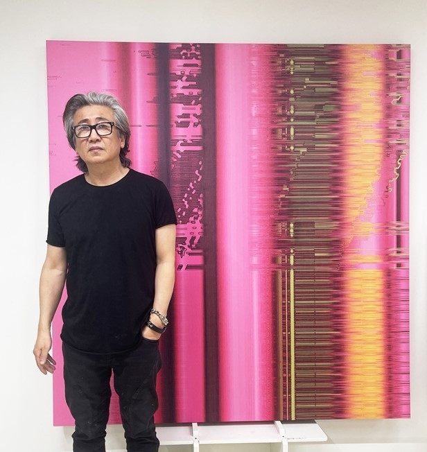 """Cody Choi poses in front of his digital work, """"Multiplying Difference: Abstraktes Bild,"""" which was printed to display the work physically. (Courtesy of the artist)"""