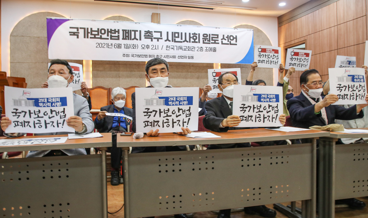 A civil activist group petitions for the abolishment of the National Security Act, June 1, 2021. (Yonhap)