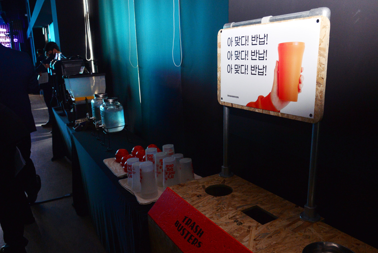 Reusable eco-friendly cups from Trash Busters are displayed at the venue. (Park Hyun-koo/The Korea Herald)