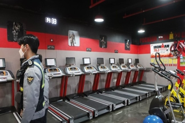 Police inspect a new gym in Pocheon, Gyeonggi Province, in January, prior to its opening. (Yonhap)