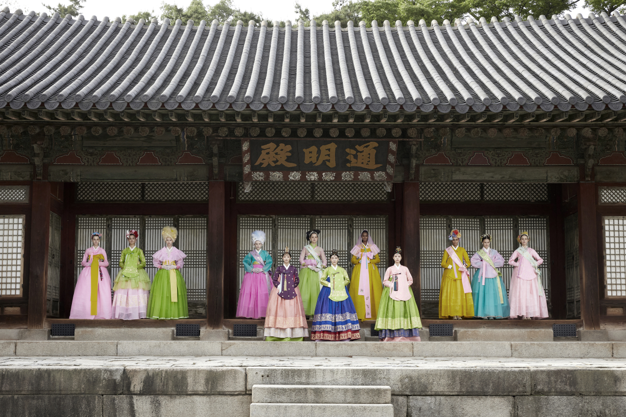 """A scene from a promotional video which will feature models wearing fashion designer Kim Young-jin's hanboks that are specially made with theme """"flower and spring."""" (CHA)"""