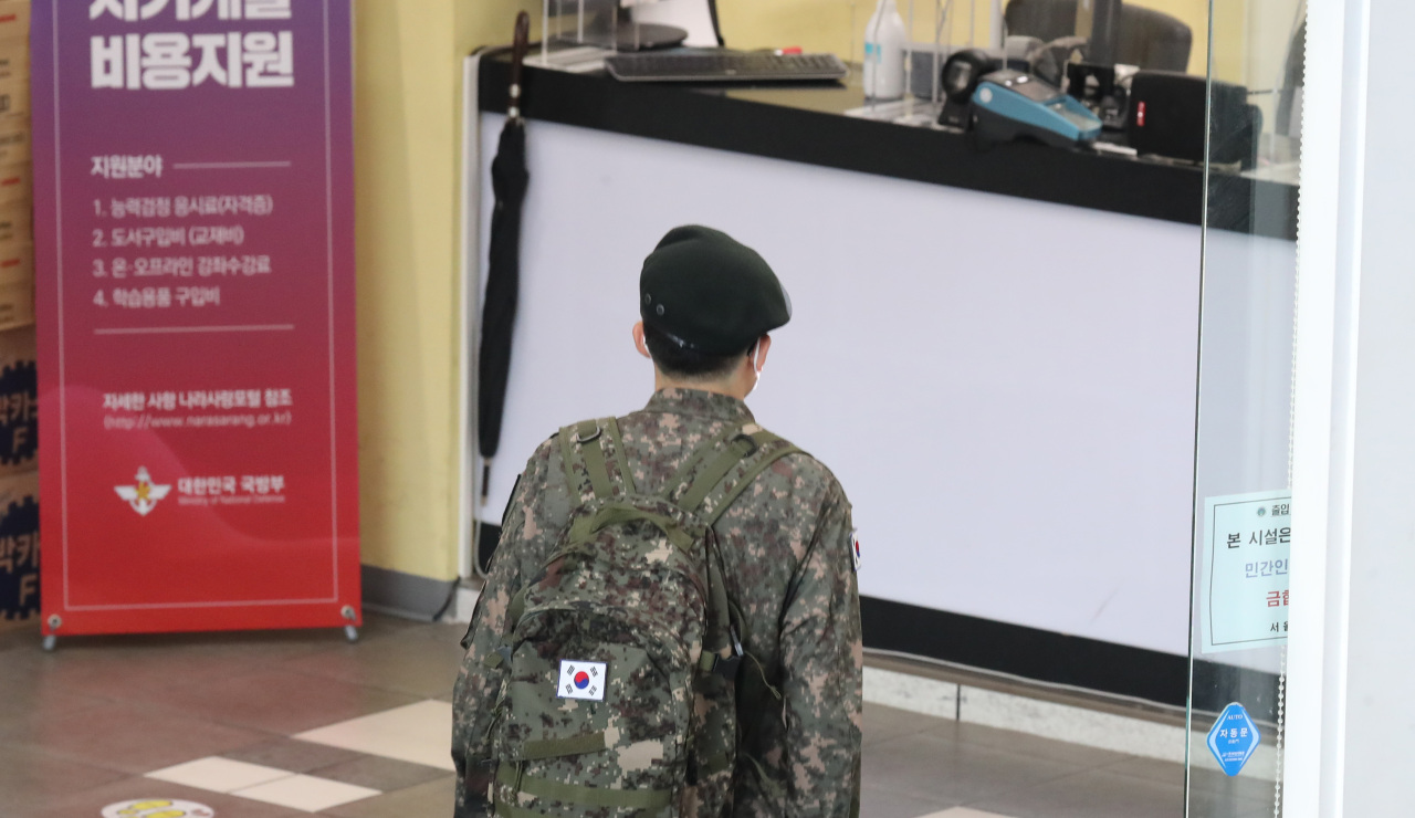 This file photo, taken on May 23, 2021, shows a service member at Seoul Station. (Yonhap)