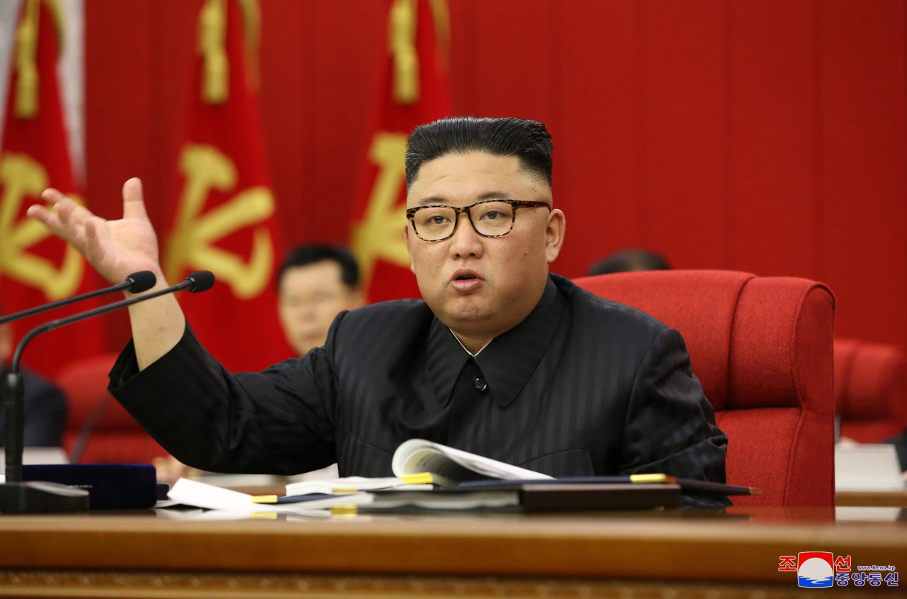 North Korean leader Kim Jong-un speaks at a plenary meeting of the ruling Workers' Party, in this photo disclosed by state media on Wednesday. (Korean Central News Agency)