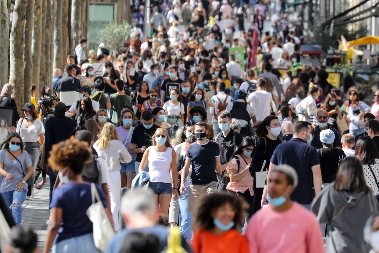 In this file photo taken on August 27, 2020 people wearing face masks walk on the Champs Elysees Avenue in Paris. (AFP-Yonhap)