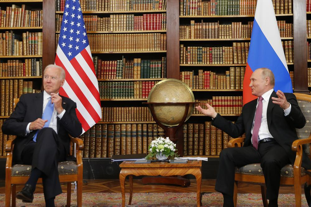 US President Joe Biden, left, and Russia's President Vladimir Putin, right, meet for the US-Russia summit at Villa La Grange in Geneva, Switzerland, Wednesday. (AP)