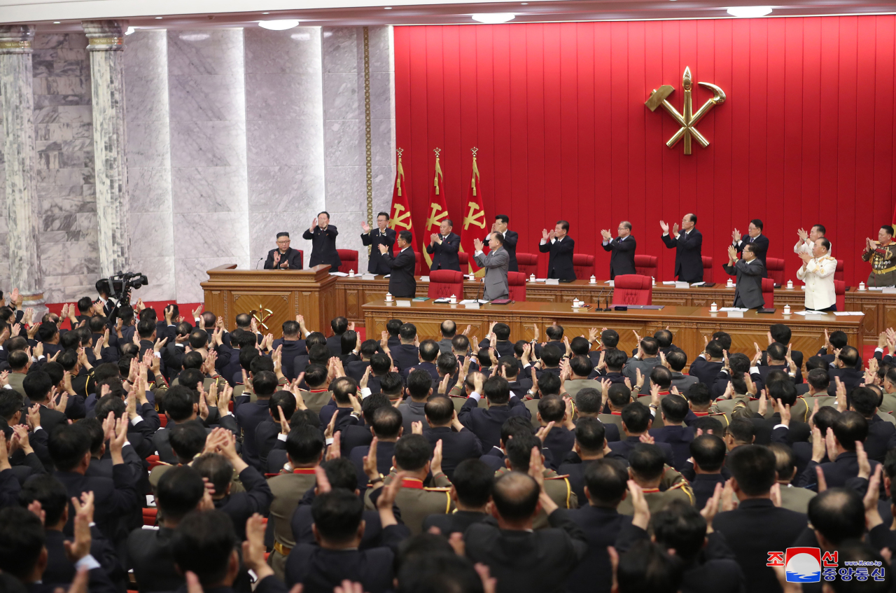 Participants applaud North Korean leader Kim Jong-un (L, at the podium) at the third plenary meeting of the eighth Central Committee of North Korea's Workers' Party on its third-day schedule in Pyongyang last Thursday, to discuss international affairs, including the Biden administration's North Korea policy, in this photo provided by the Korean Central News Agency. (For Use Only in the Republic of Korea. No Redistribution) (Yonhap)