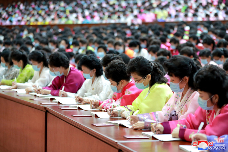 Wearing blue face masks, delegates from North Korean women's union organizations take notes during the seventh Congress of the Socialist Women's Union, a wing of North Korea's ruling Workers' Party of Korea, in Pyongyang, in this undated photo released by the North's official Korean Central News Agency on Tuesday. In his letter sent to the congress that was held from Sunday to Monday, North Korean leader Kim Jong-un congratulated the congress on behalf of the party's Central Committee, the KCNA said. (Korean Central News Agency)