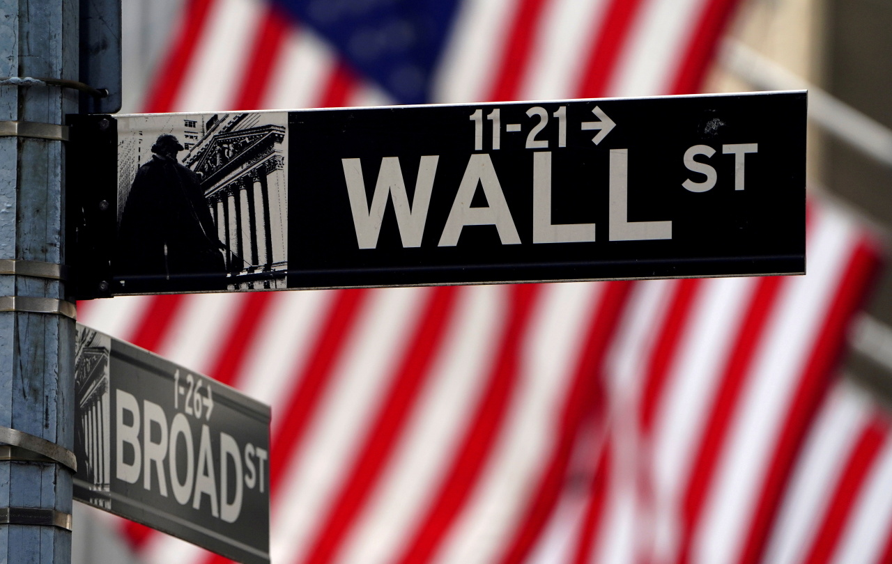 A Wall Street sign outside the New York Stock Exchange in the Manhattan borough of New York City, New York, US, April 16, 2021. (Reuters)