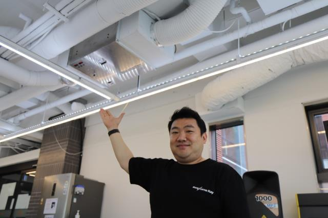 AweXome Ray Founder and CEO Gihm Se Hoon points at a ventilation in which his company's air pufication and sterilization equipment that uses the next generation X-ray technology. (D.Camp)