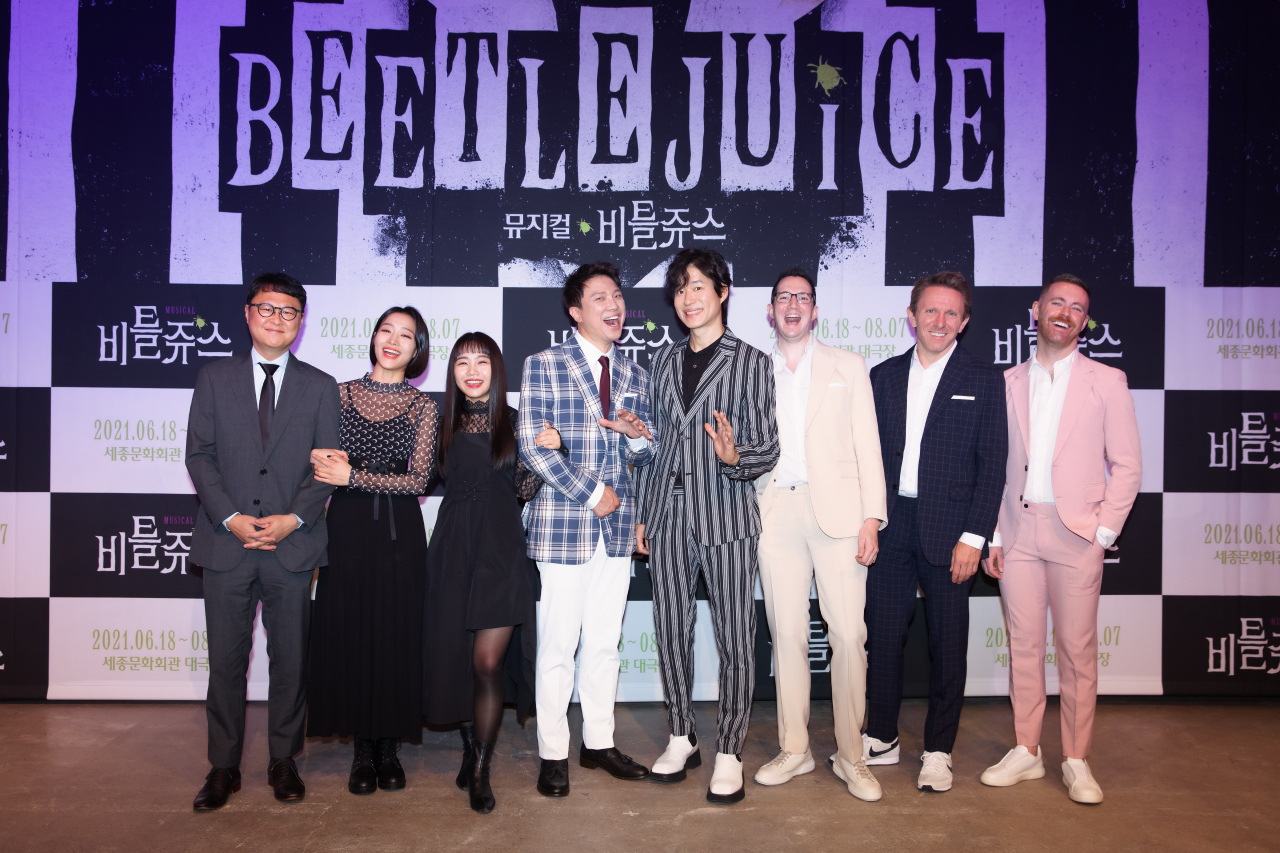 """Cast members and production staff of musical """"Beetlejuice"""" pose for photos after a press event held online on May 24. (CJ ENM)"""