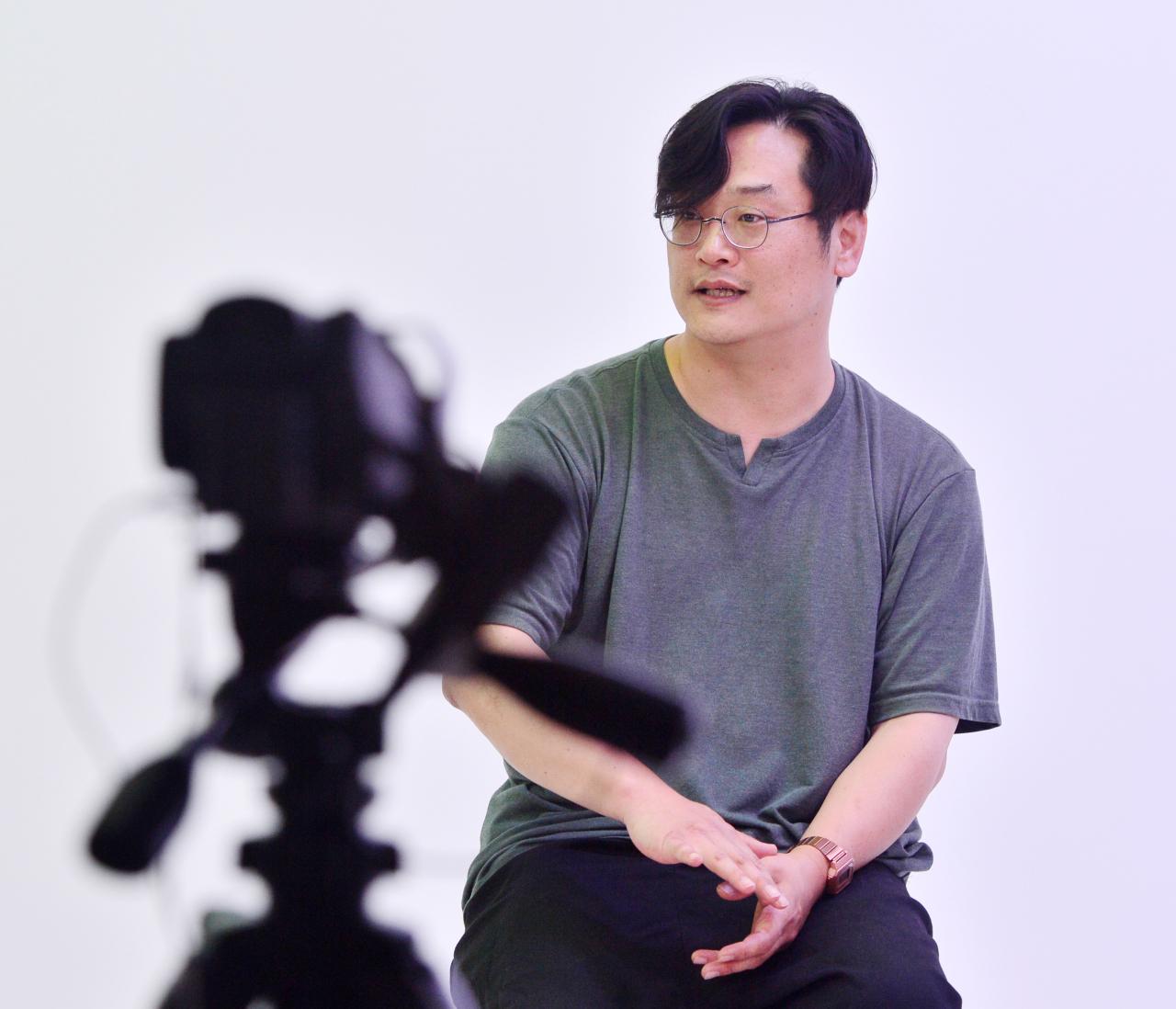 Pop music critic Cha Woo-jin speaks during an interview with The Korea Herald at Herald Studio on June 23. (Park Hyun-koo/ The Korea Herald)
