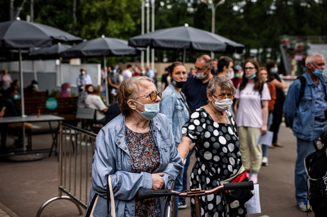 People wait in line to get a coronavirus, Covid-19, vaccine at a vaccination center in Sokolniki Park in Moscow on Friday. (AFP)