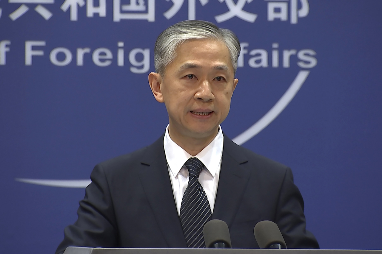 China's Foreign Ministry spokesperson Wang Wenbin speaks during the daily briefing in Beijing. China on Friday. (AP)