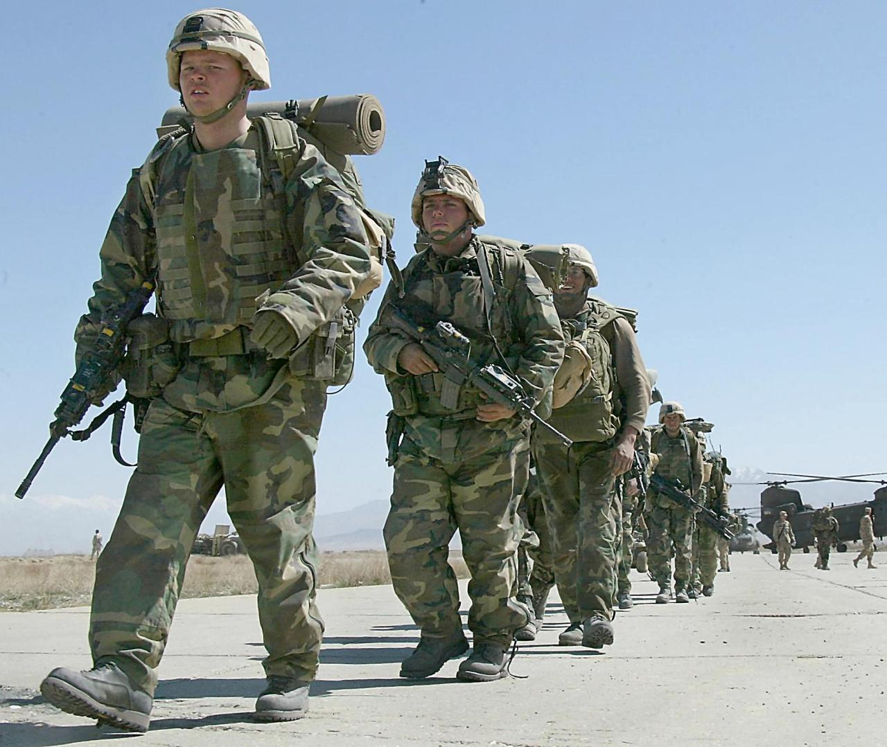 In this file photo taken on March 12, 2002, US soldiers arrive at Bagram Air Base, in Bagram. (AFP)
