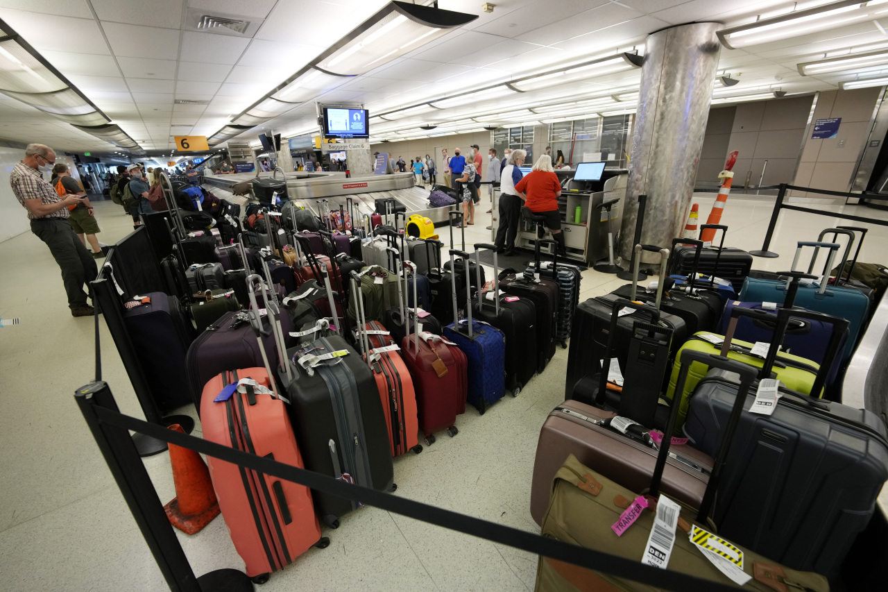Baggage stacks up from delayed travellers in the baggage claim area in Denver International Airport Wednesday, June 16, 2021, in Denver. (AP)