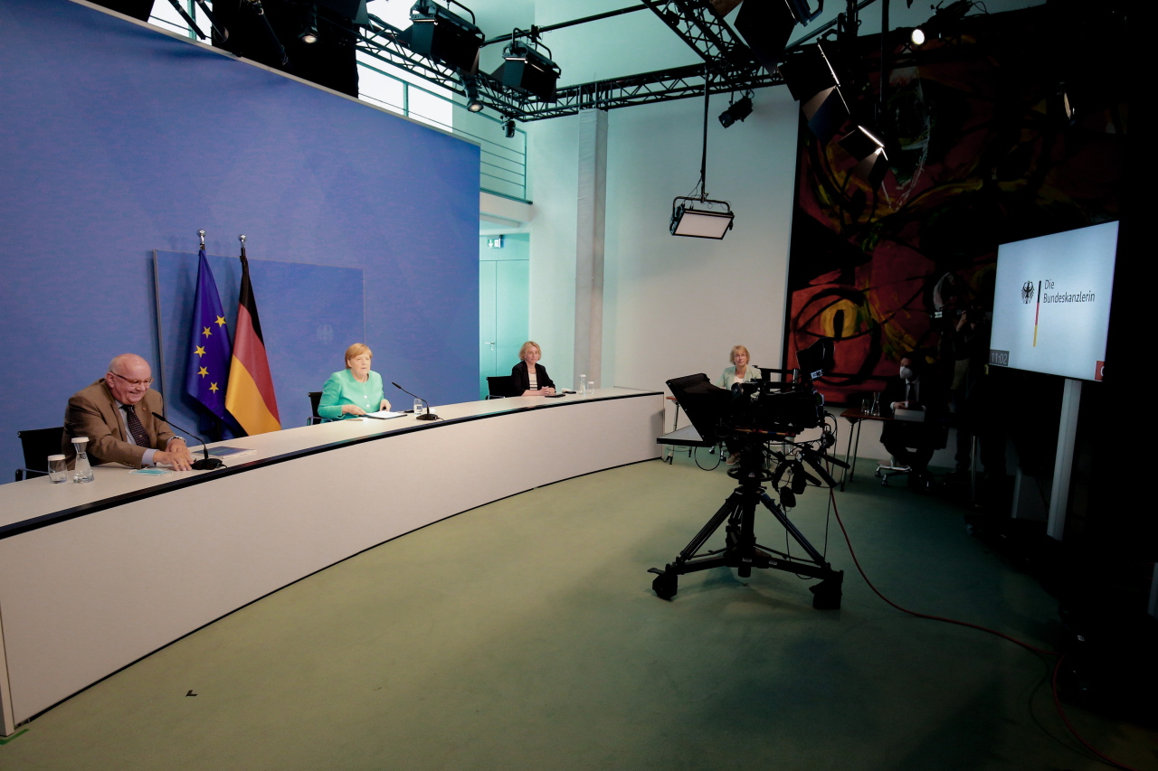 German Chancellor Angela Merkel (middle) attends the virtual handover of the final report of the 'Future Commission for Agriculture' at the Chancellery in Berlin, Germany, on Tuesday. (EPA-Yonhap)