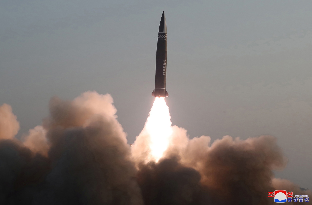 A new type of a tactical guided missile is launched from the North Korean town of Hamju, South Hamgyong Province, on March 25, 2021, in this photo released by the North's official Korean Central News Agency. South Korea's military said the previous day that the North fired what appeared to be two short-range ballistic missiles into the East Sea. (Yonhap)