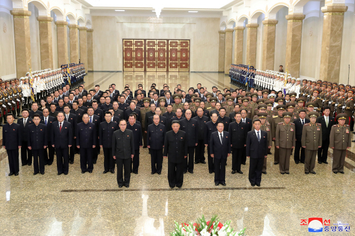 North Korean leader Kim Jong-un (2nd from L, front row) stands alongside members of the Presidium of the Politburo of the Workers' Party of Korea, as he visits the Kumsusan Palace of the Sun in Pyongyang on July 8, 2021, to pay tribute to his grandfather and North Korea's founder, Kim Il-sung, on the occasion of the 27th anniversary of the former leader's death, in this photo released by the North's official Korean Central News Agency. Ri Pyong-chol (3rd row, in circle), vice chairman of the Central Committee of the Workers' Party, is seen on the third row in an indication that he might have been removed from the Presidium at its meeting late last month. The mausoleum enshrines the mummified bodies of Kim Il-sung and Kim Jong-il, the current leader's father. (Korean Central News Agency)