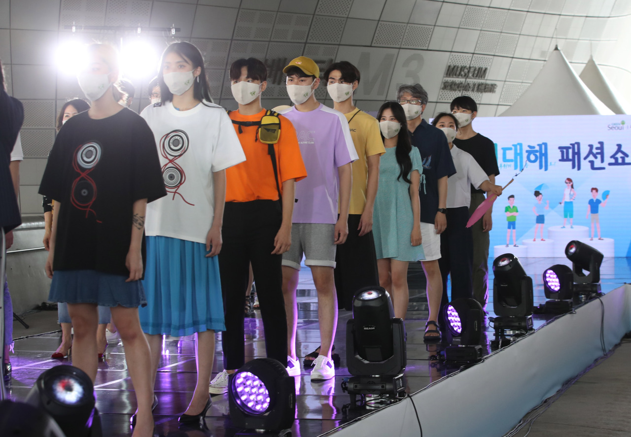 Models in eco-friendly outfits and accessories strut down the runway Friday. (Yonhap)
