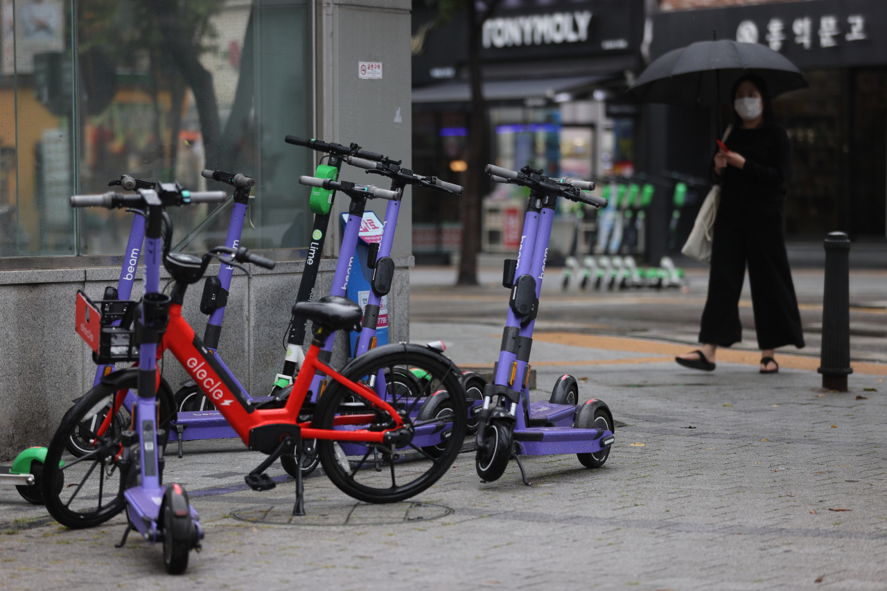 Electric scooters are parked by an entrance of a subway station in Seodaemun-gu, western Seoul, on July 7, 2021. (Yonhap)