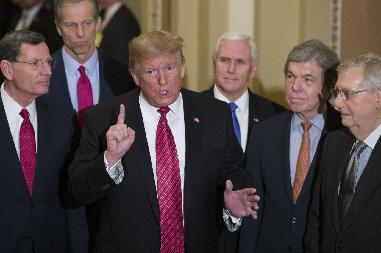 In this Jan. 9, 2019 file photo, Sen. John Barrasso, R-Wyo., left, and Sen. John Thune, R-S.D., stand with President Donald Trump, Vice President Mike Pence, Sen. Roy Blunt, R-Mo., and Senate Majority Leader Mitch McConnell of Ky., as Trump speaks while departing after a Senate Republican Policy luncheon, on Capitol Hill in Washington. (AP-Yonhap)