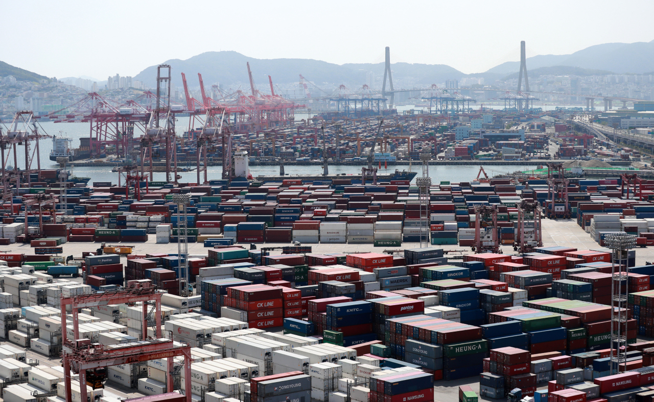This file photo, taken June 1, 2021, shows ships carrying containers docking at a port in the southeastern city of Busan. (Yonhap)