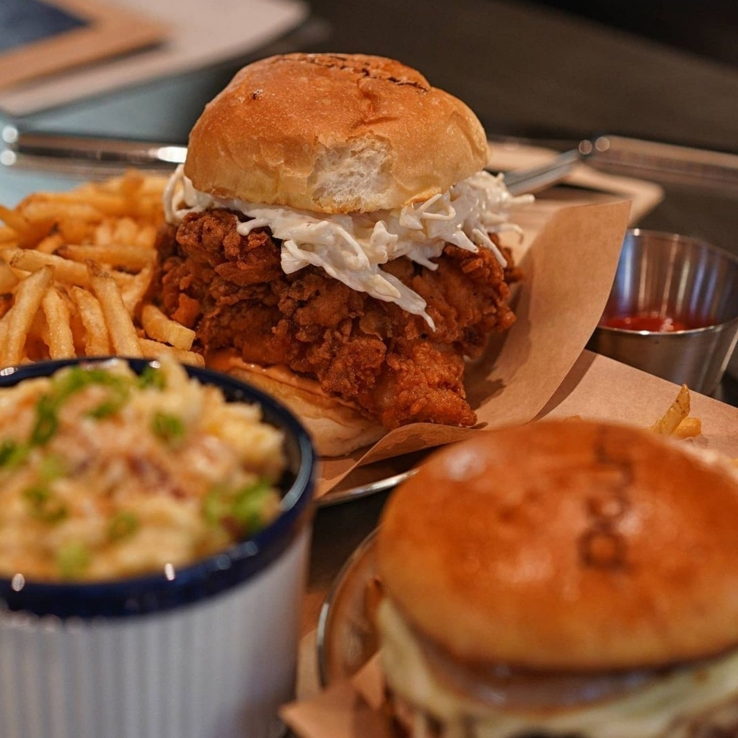 Pound's boneless fried chicken thigh is so huge that it sort of drapes over the edges of its bun. (poundseoul)