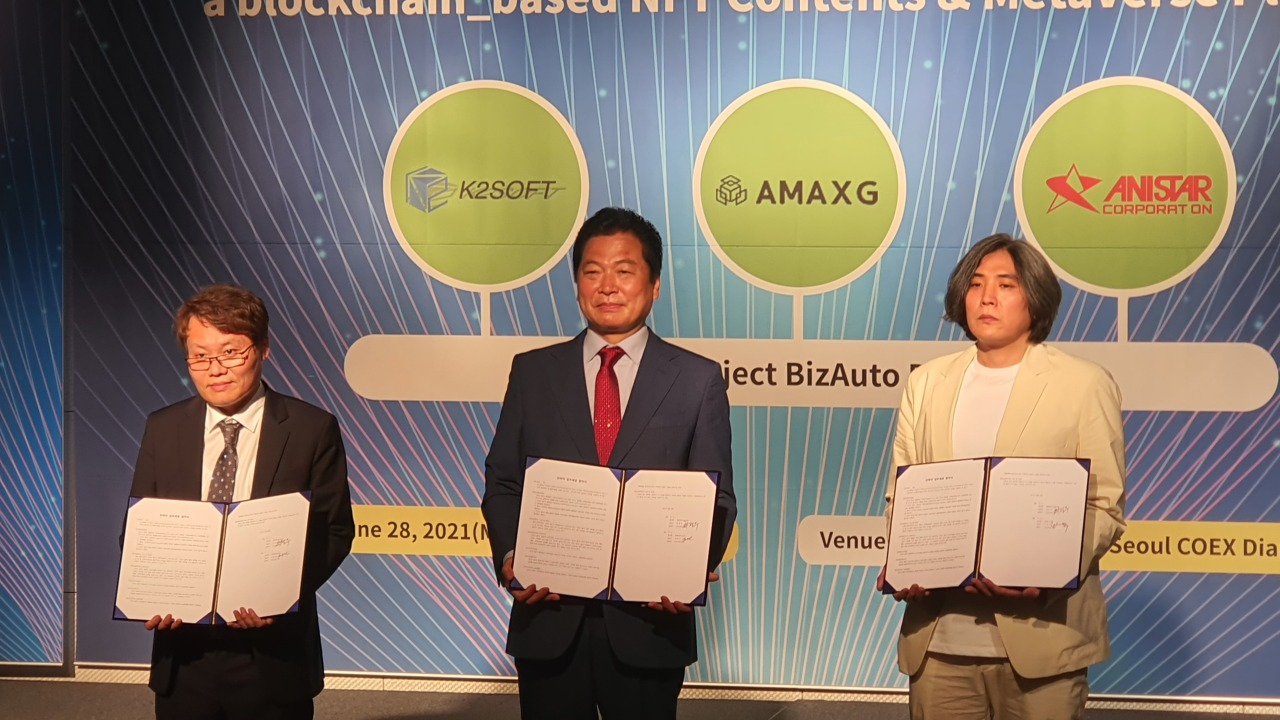 K2Soft CEO Kim Young-oh, AMAXG CEO Choi Jeong-moo, and Anistar CEO Noh Seoung-taek participate in the signing ceremony of partnership among the three companies in Seoul on June 28. (AMAXG)