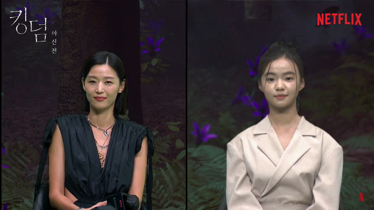 """Actors Jun Ji-hyun (left) and Kim Sia, both of whom play Ashin, participate in the virtual press conference for """"Kingdom: Ashin of the North"""" on Tuesday. (Netflix)"""