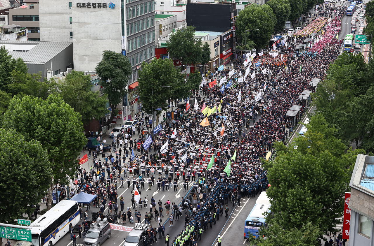 In the July 3, 2021, file photo, members of the Korean Confederation of Trade Unions (KCTU) march down a street in Jongno Ward during a rally in Seoul. (Yonhap)