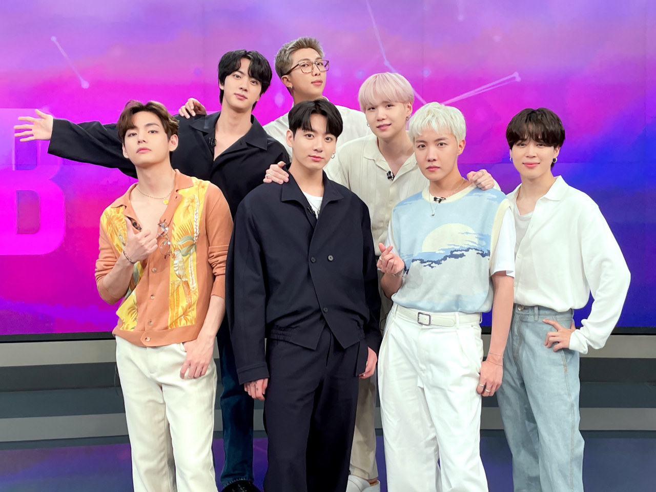 This photo, posted on BTS' official Twitter account, shows the group posing at a studio during its appearance on SBS News on Saturday. (BTS' official Twitter account)