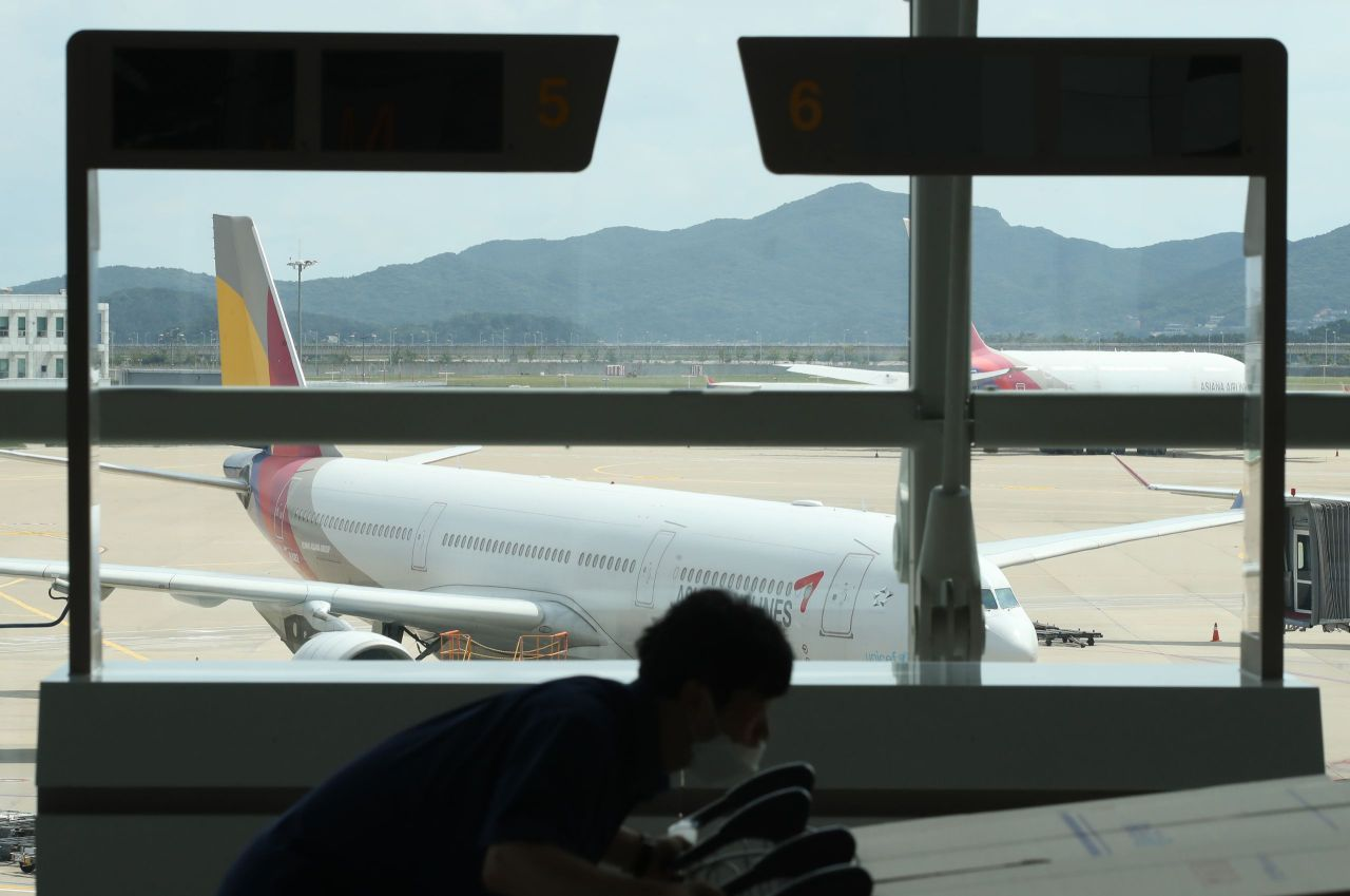 An Asiana Airlines plane is seen through the window at Incheon Airport's Terminal 1. (Yonhap)