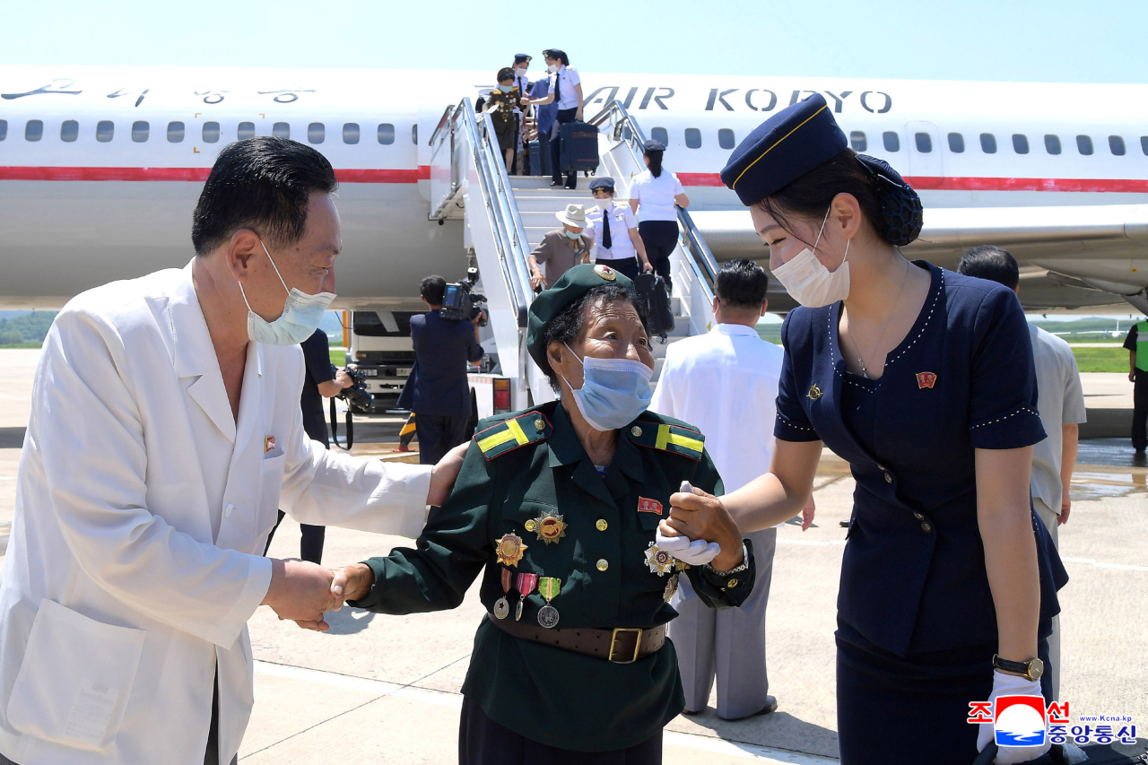 North Korea's war veterans arrive in Pyongyang on July Sunday to attend a national conference to celebrate the 68th anniversary of the Korean War armistice on July 27. (KCNA-Yonhap)