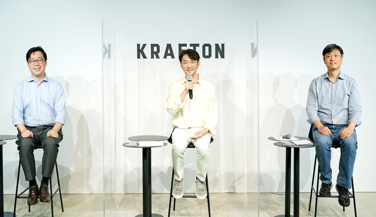 From left: Krafton Chief Financial Officer Bae Dong-keun, CEO Kim Chang-han and Chairman Chang Byung-gyu speak at an online briefing with reporters Monday. (Krafton)