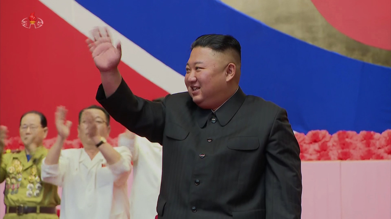 North Korean leader Kim Jong-un waves as he attends a national conference of war veterans on Tuesday, to commemorate the 68th anniversary of the Korean War armistice, in this photo captured from the North's Korean Central Television the next day. North Korea refers to the three-year conflict as the great Fatherland Liberation War. (North's Korean Central Television)