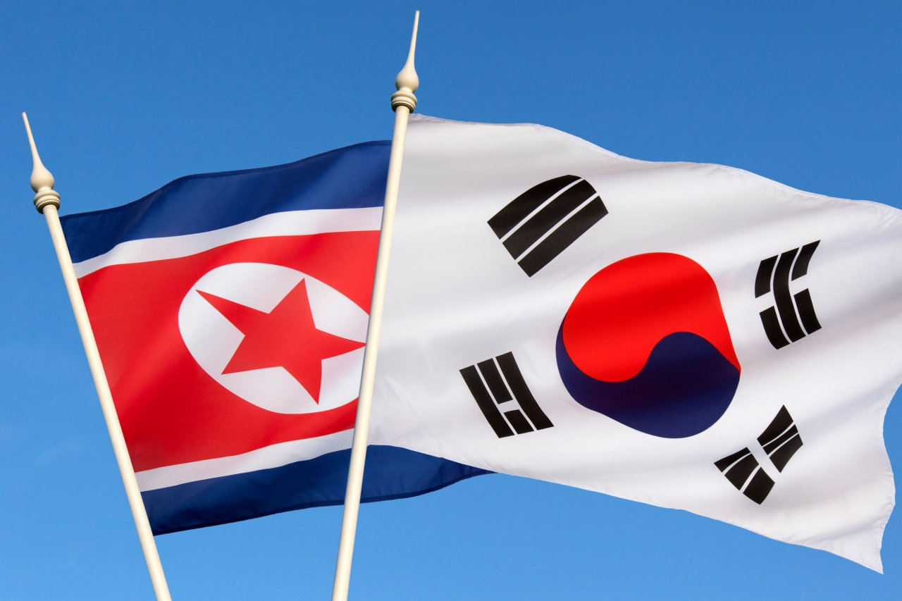 The flags of South and North Korea (123rf)