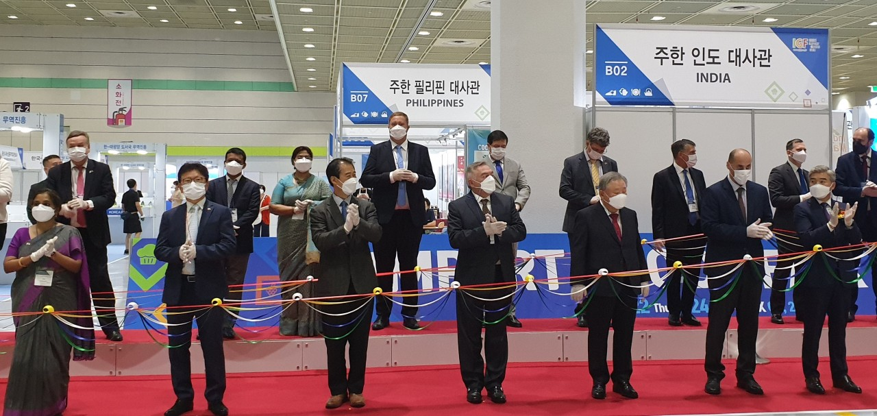 TRADE PARTNERS -- Ambassadors and representatives of the embassies and Korea Importers Association inaugurate the 18th Import Goods Fair that was held Thursday to Saturday at Coex in Seoul. The fair was organized by the Korea Importers Association to showcase new products imported from partner countries. Forty embassies and 22 foreign companies attended as part of the fair. (Embassy of Bangladesh in Seoul)