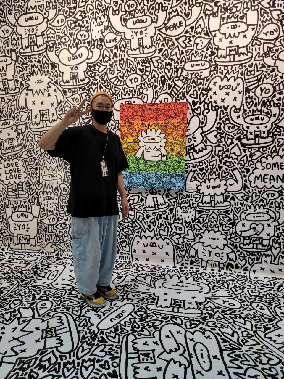 Doodle artist Yoyojin poses in front of his work at 2021 Urban Break (Park Yuna/The Korea Herald)