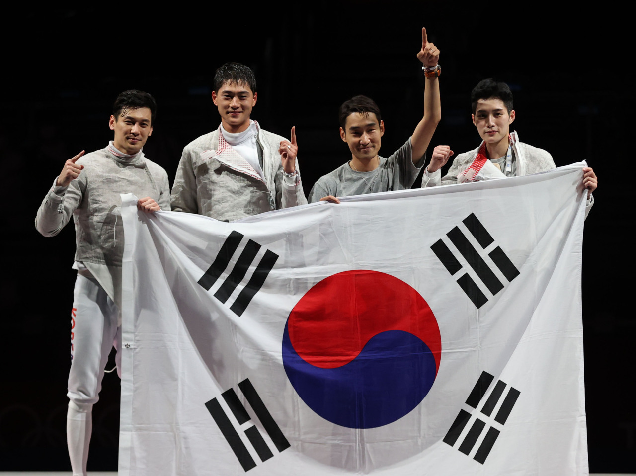 South Korean fencers Gu Bon-gil, Oh Sang-uk, Kim Jung-hwan and Kim Jun-ho (L to R) celebrate their victory over Italy in the final of the men's team sabre fencing event at the Tokyo Olympics at Makuhari Messe Hall B in Chiba, Japan, on Wednesday. (Yonhap)
