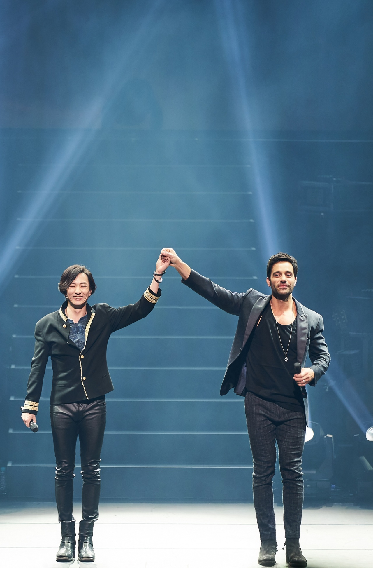 """Michael Lee (left) and Ramin Karimloo perform during a concert titled """"Music of the Night"""" at the Sejong Center for the Performing Arts in Seoul in 2019. (Clip Service)"""