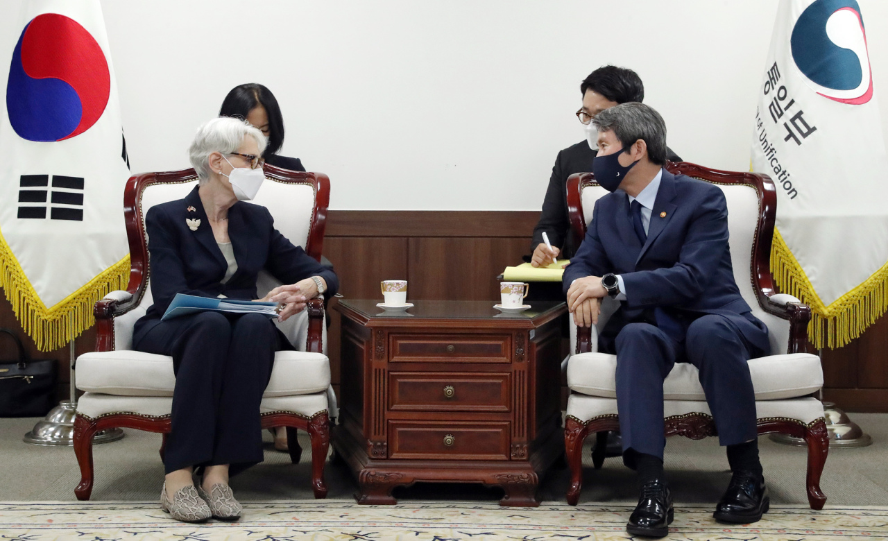 South Korean Unification Minister Lee In-young (R) talks with US Deputy Secretary of State Wendy Sherman during their meeting at the government complex in Seoul on July 22, 2021, in this photo released by the ministry. (South Korean Unification Ministry)
