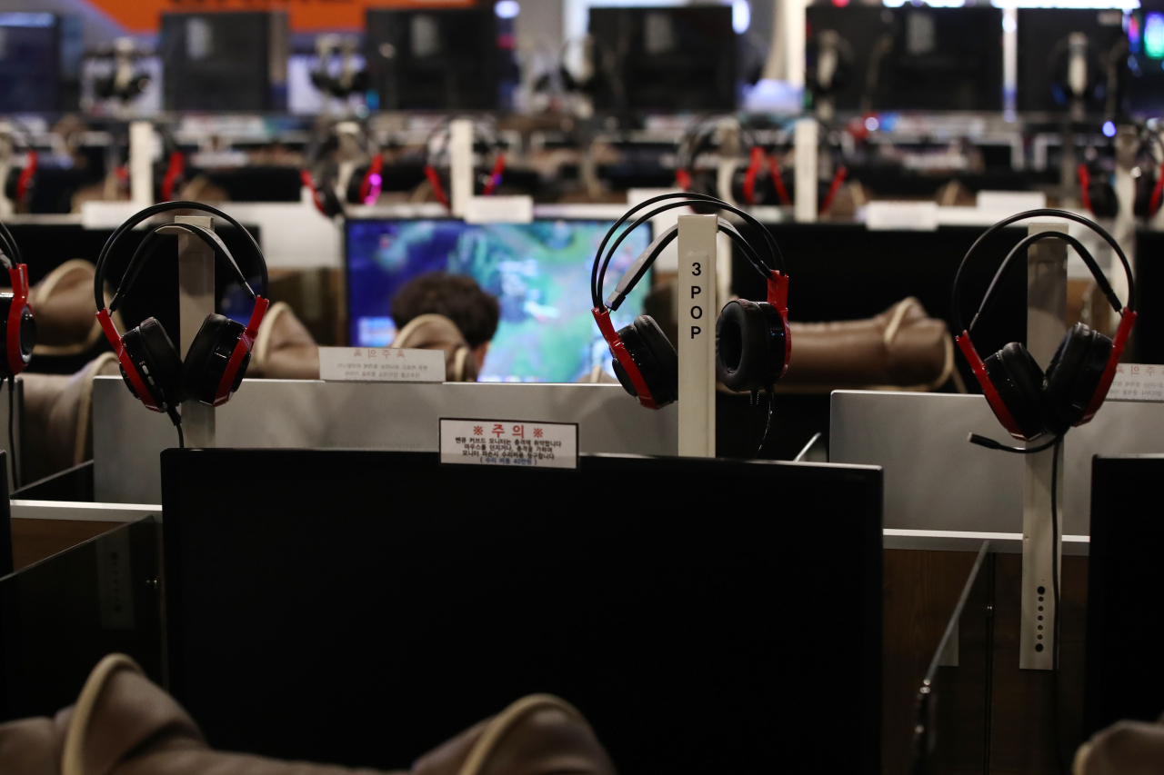 South Koreans play games at an internet cafe known as