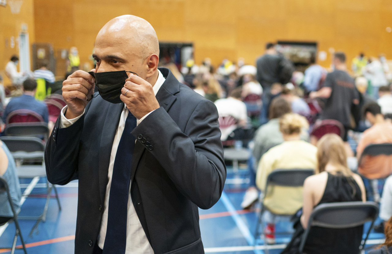 Britain's Health Secretary Sajid Javid speaks to the media during a visit to a pop-up vaccination site at a sports centre in west London, Wednesday July 28. (AP-Yonhap)