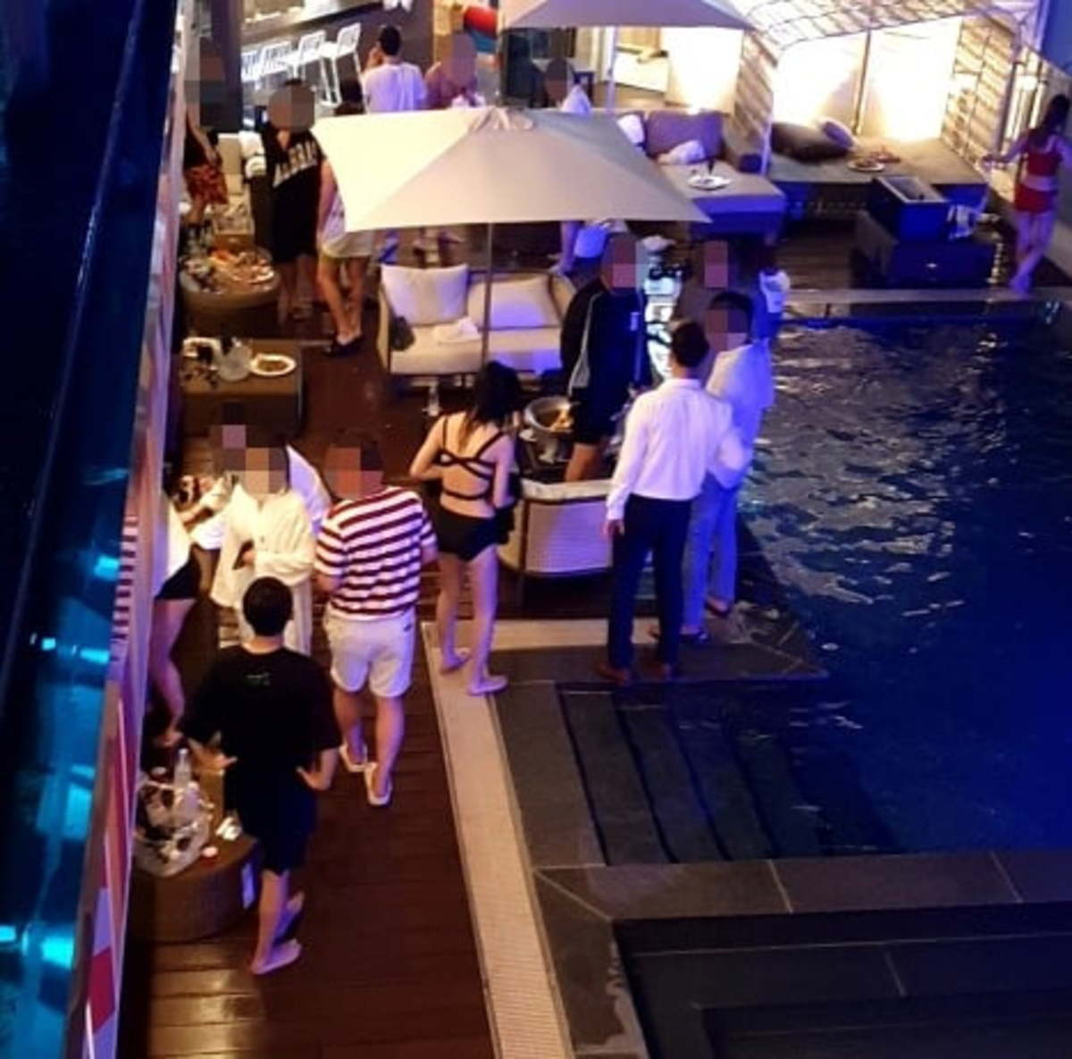 This photo, provided by the Gangneung city government, shows the scene of a pool party at a hotel in Gangneung on Saturday. (Gangneung city government)