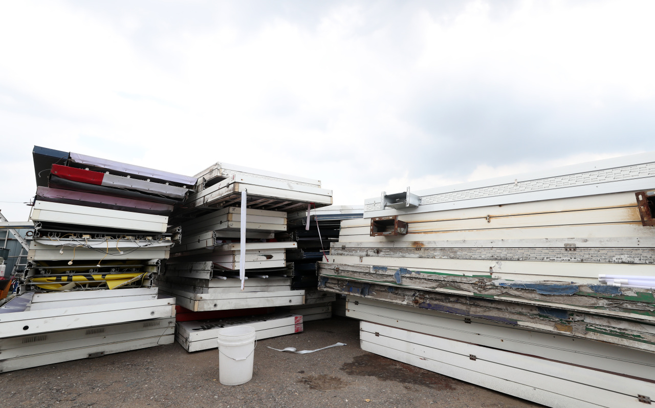A pile of sign boards is seen at a dumpsite in Bucheon, Gyeonggi Province, on Wednesday, as the prolonged pandemic has forced thousands of stores to shut down. (Yonhap)
