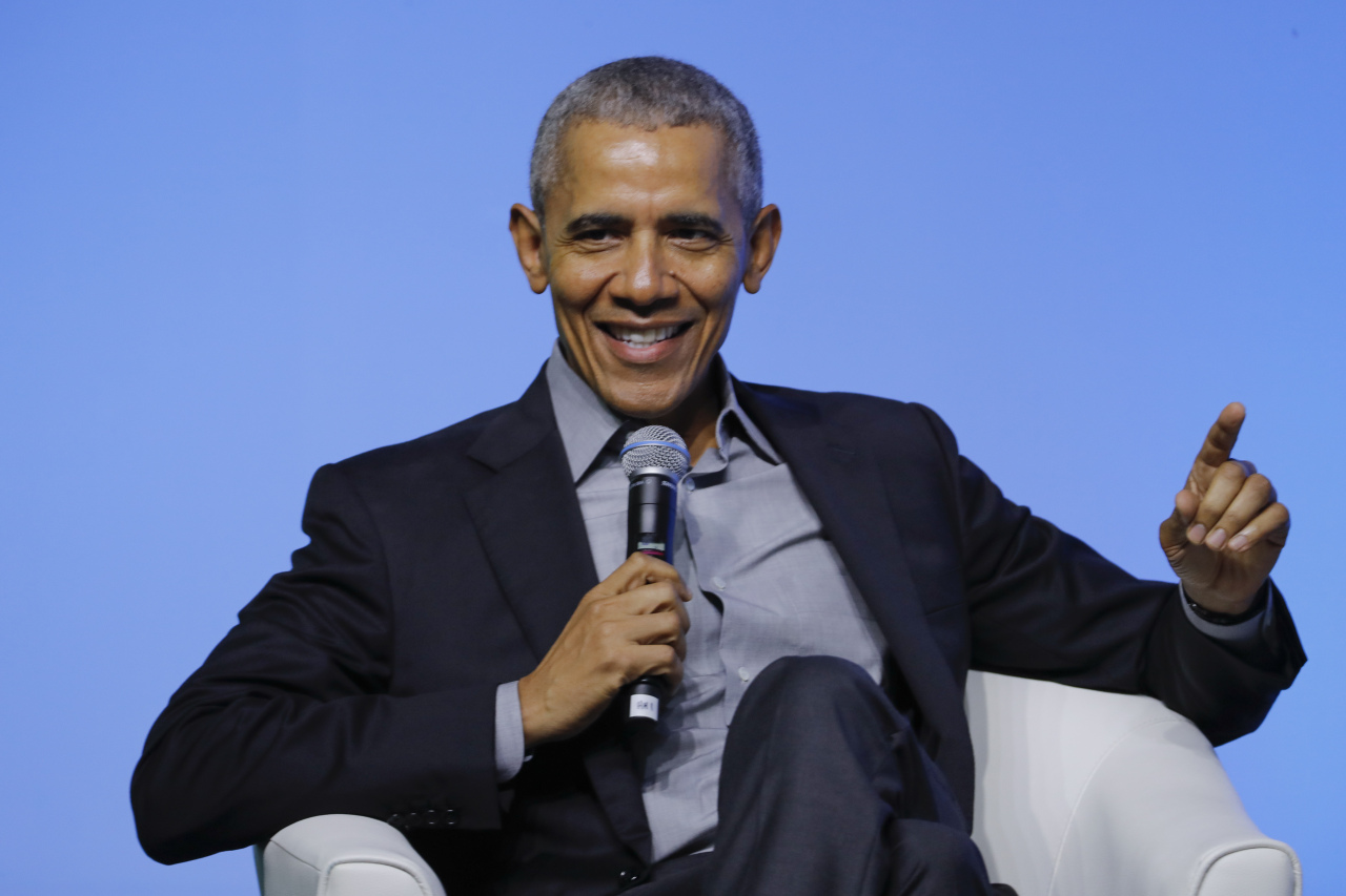 Former US President Barack Obama gesture as he attends the