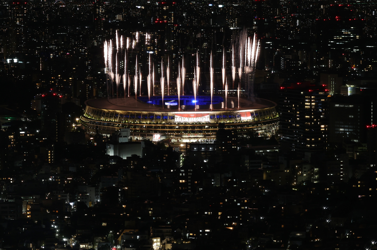 Fireworks go off at the National Stadium in Tokyo at the start of the closing ceremony for the Tokyo Olympics on Sunday. (Yonhap)