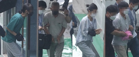 This Aug. 2, 2021, file photo shows four South Korean activists entering the Cheongju District Court, about 140 kilometers south of Seoul, to attend an arrest warrant hearing for allegedly taking orders from North Korea to stage anti-weapons protests. (Yonhap)