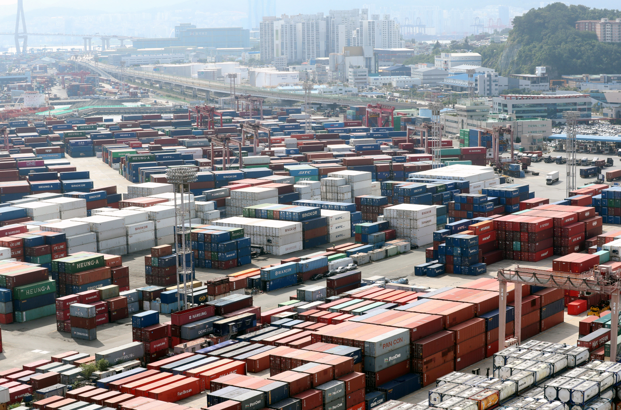 Shipping containers sit in the Busan Port Terminal (BPT) at the Port of Busan in Busan. (Yonhap)
